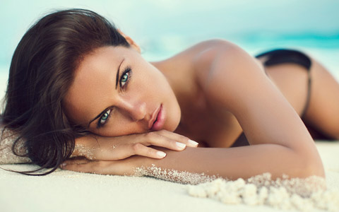 young woman lying on beach from injectables website by Columbus SEO firm Sevell