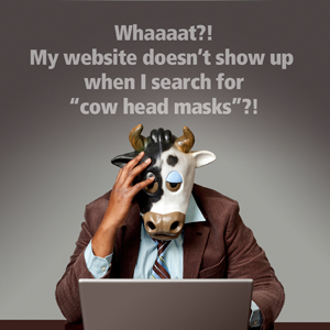 man in cow head mask searching online for Columbus website design